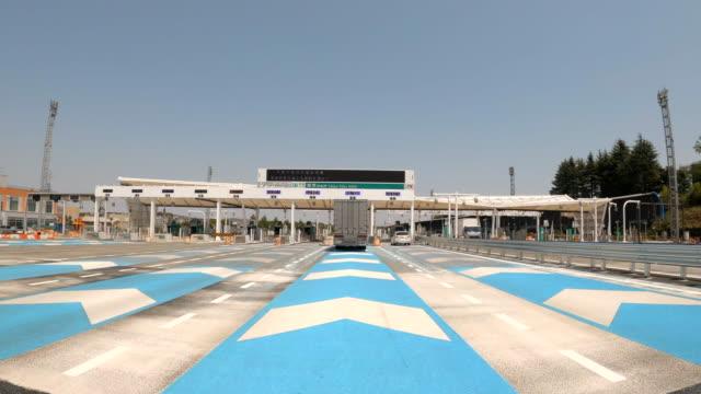 highway toll gate passing - glowing doorway stock videos & royalty-free footage