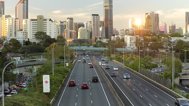 highway traffic and city skyline - transportation stock videos & royalty-free footage