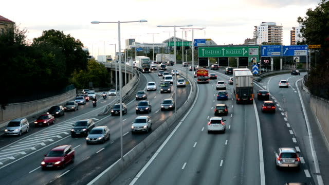 highway traffic at dusk - traffic stock videos & royalty-free footage