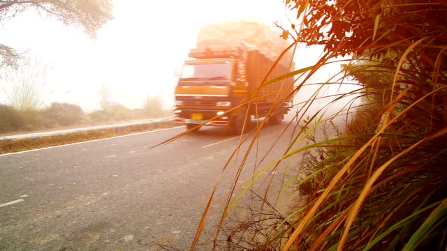 highway traffic during fog, mist & smog - trucks in a row stock videos & royalty-free footage
