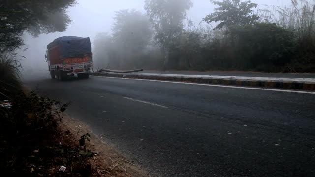 highway traffic during fog, mist & smog - smog stock videos & royalty-free footage
