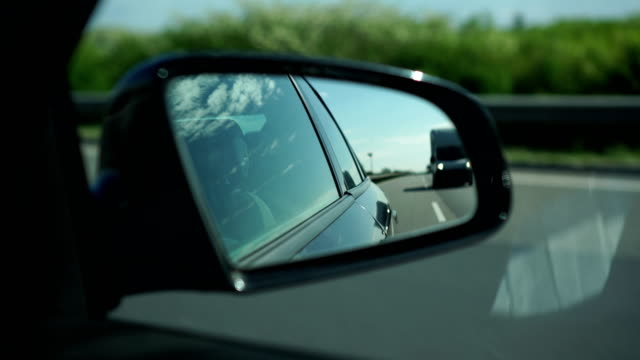 highway traffic, rear-view mirror - rear view mirror stock videos & royalty-free footage