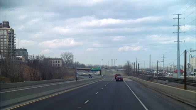 highway traffic takes the grand avenue exit near the dayton international airport. - dayton ohio stock videos & royalty-free footage
