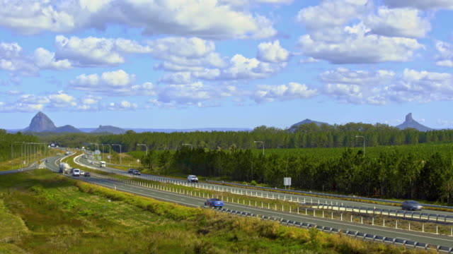 highway traffic weaving through mountains 4k - queensland stock videos & royalty-free footage