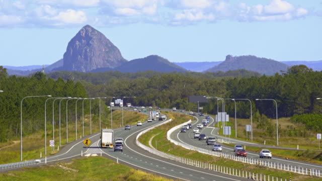 highway traffic weaving through mountains 4k - motorway stock videos & royalty-free footage