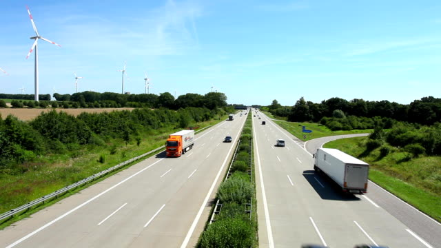 highway traffic with wind energy in germany - major road stock videos & royalty-free footage