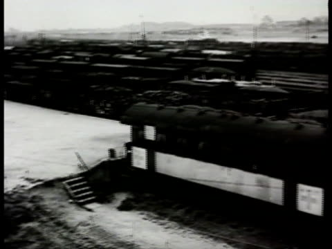 highway w/ no cars traffic pan train station pan train cars filled w/ ore or coal gravel sitting in station small boats sitting in docks canal ws... - 1948 stock-videos und b-roll-filmmaterial
