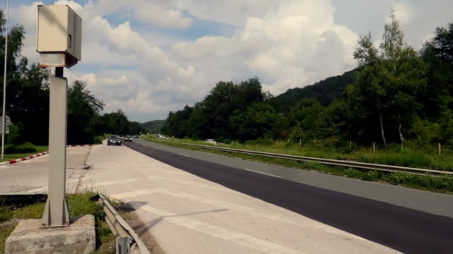 a highway with speed camera and radar on the side of the road - radar stock videos & royalty-free footage