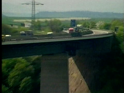 1994 montage ws ha highway with traffic moving past/ ws zo ha elevated road crossing through countryside and river/ germany/ audio - 1994 stock videos and b-roll footage