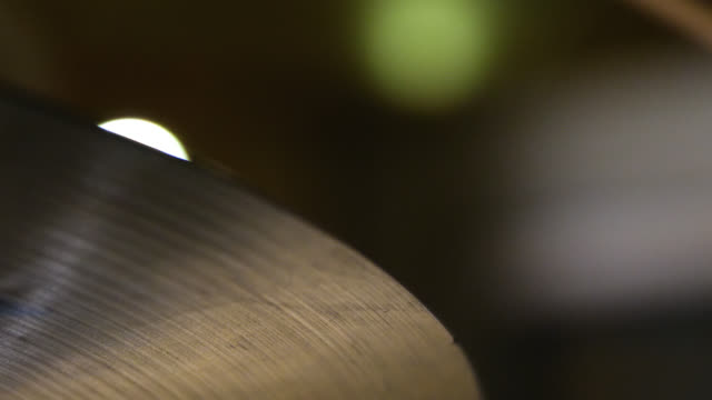 a hi-hat cymbal moves up and down in slow motion on a drum kit - cymbal stock videos and b-roll footage