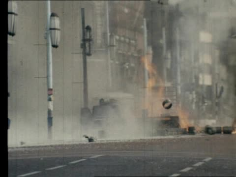 a hijacked brewery lorry loaded with 150 lbs of explosives blows up on a street near belfast city hall - 北アイルランド点の映像素材/bロール