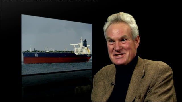 stockvideo's en b-roll-footage met hijacked tanker sirius star anchored off somali coast; location unknown: int keith michel interview sot - anchored