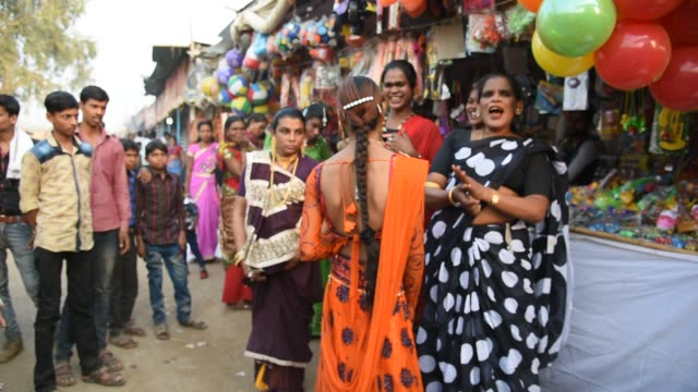 Hijra or Transgenders dance and singing at street.