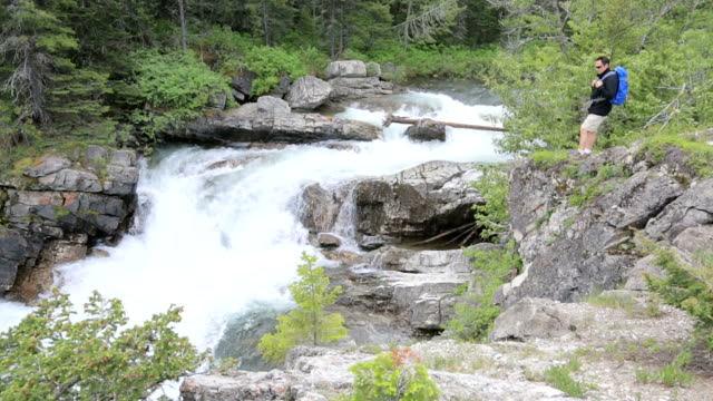 hiker admires waterfall - named wilderness area stock videos & royalty-free footage