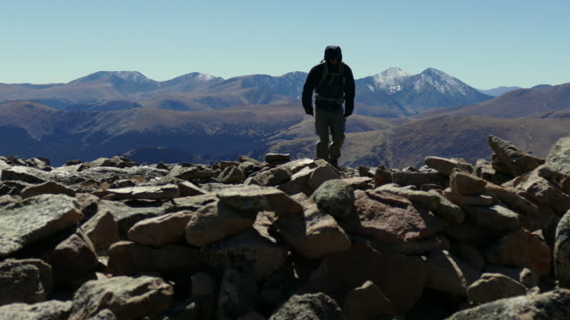 Hiker and snow dusted Front Range peaks Colorado Rocky Mountains