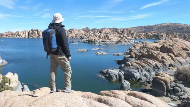 hiker at watson lake arizona usa - prescott arizona stock videos & royalty-free footage