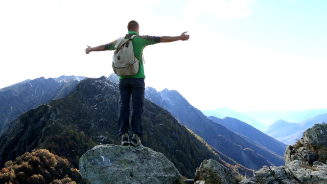 hiker celebrates success on mountain top - on top of stock videos & royalty-free footage