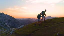 DRONE: Hiker couple enjoying an evening trip in the breathtaking Julian Alps.