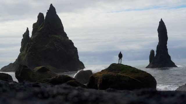 hiker explores dramatic icelandic landscapes - iceland stock videos & royalty-free footage