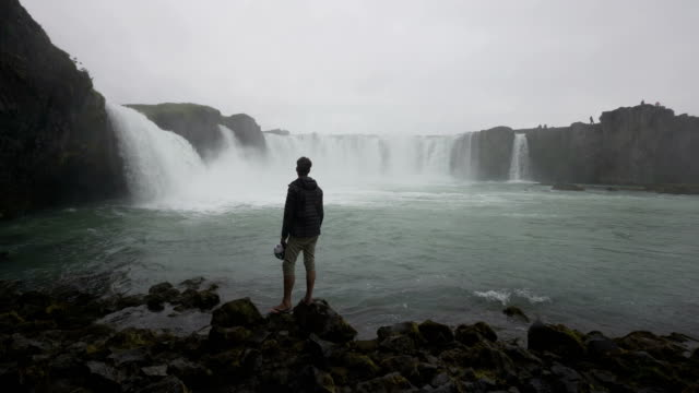 hiker explores dramatic icelandic landscapes - majestic stock videos & royalty-free footage