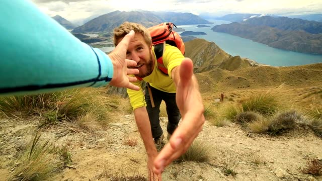 hiker hiking pulls out hand to get assistance from teammate - help single word stock videos and b-roll footage