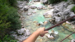 POV Hiker holding the wire rope on a bridge