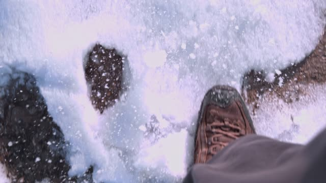 hiker in boots walking in snow, super slow motion - stepping stock videos & royalty-free footage