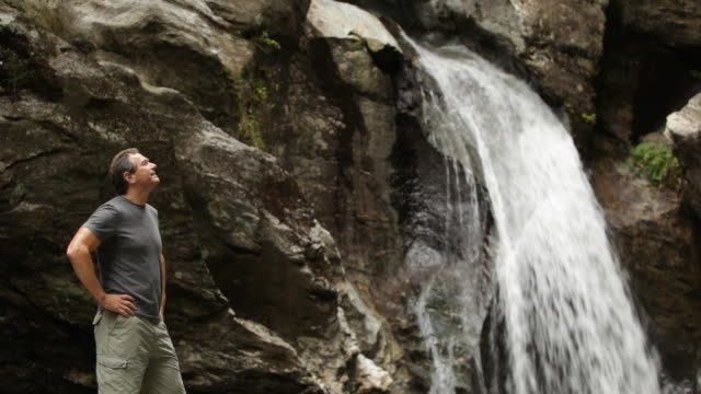 ms hiker looking up at waterfall / stowe, vermont, united states - stowe vermont stock videos & royalty-free footage