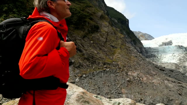 hiker looks up at glacier - only mature men stock videos & royalty-free footage