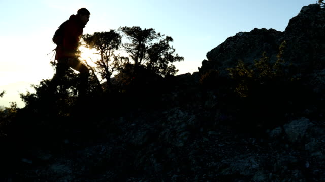 hiker makes his way up mediterranean peak with dramatic view behind - piedmont italy stock videos & royalty-free footage