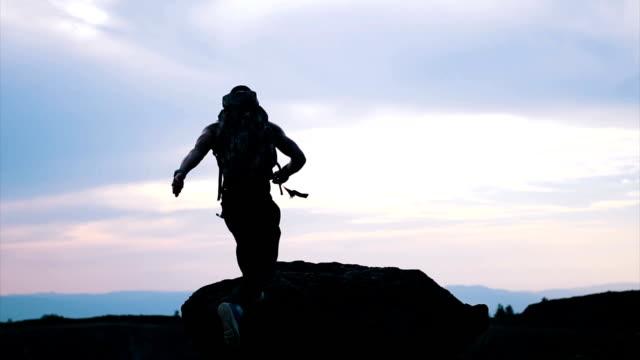 Hiker man using compass
