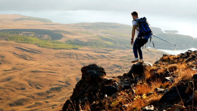 hiker on mountains enjoy sunrise - passion stock videos & royalty-free footage
