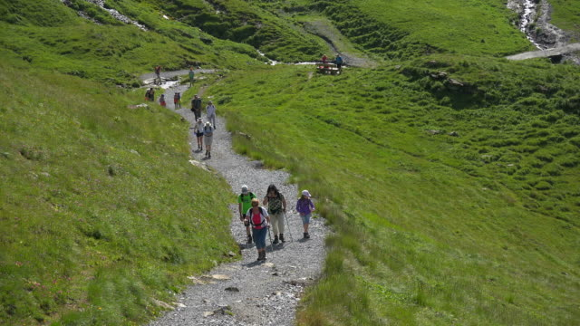 Hiker on the way to the Faulhorn, Grindelwald-First, Bernese Alps, Switzerland, Europe