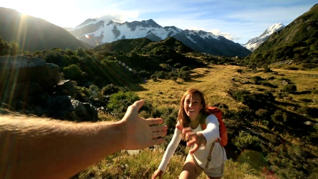 hiker pulls out hand to get assistance from teammate - hiking stock videos & royalty-free footage