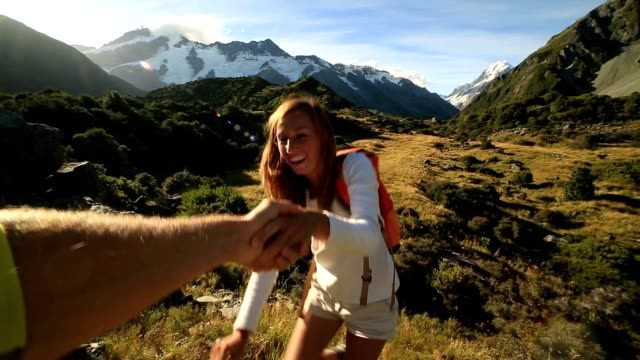 hiker pulls out hand to get assistance from teammate - reaching stock videos & royalty-free footage