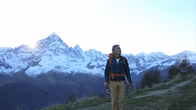 Hiker reads signpost, continues onwards journey