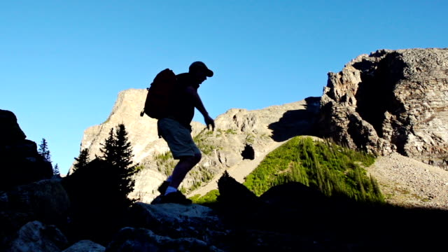 Hiker silhouetted against mountians