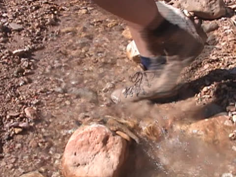 hiker steps through stream - boot stock videos & royalty-free footage