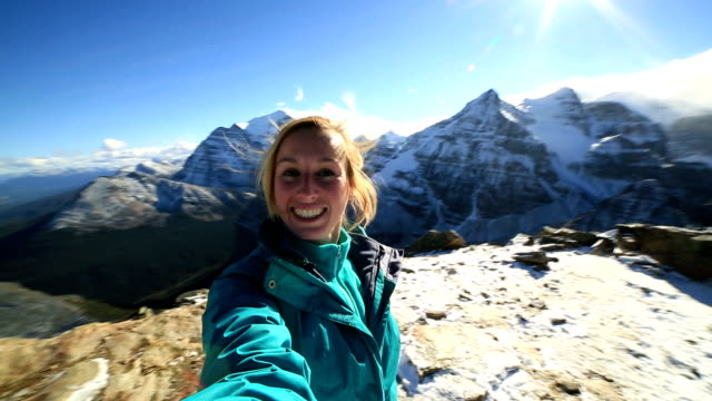 Hiker takes 360 degree selfie on mountain peak