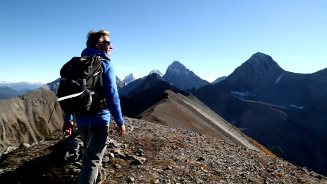 hiker takes final steps to mountain summit - on top of stock videos & royalty-free footage