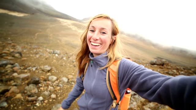 hiker takes selfie portrait on mountain trail - north island new zealand stock videos & royalty-free footage