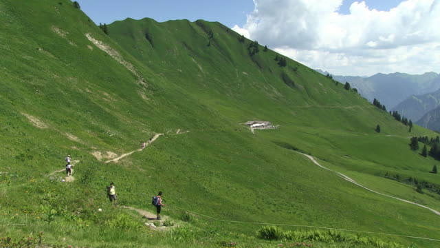 ws hiker walking on hiker path  near schlappold alm / oberstdorf, bavaria, germany - alm stock-videos und b-roll-filmmaterial
