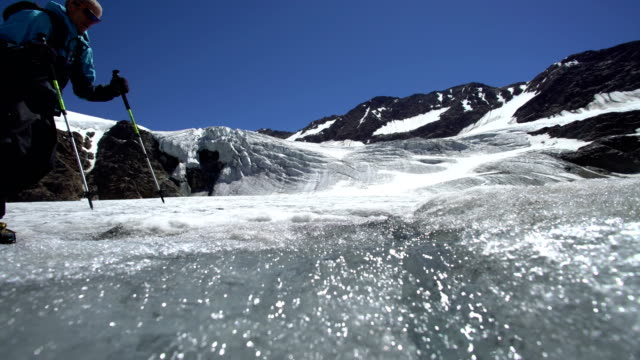 Hiker walking on the glacier to the top of the mountain