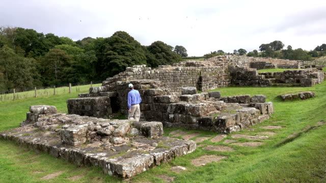 hiker walks along hadrian's wall turrets bridge willowford cumbria gilsand uk - castle stock videos & royalty-free footage