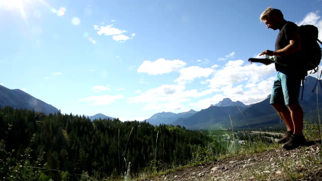 hiker walks along mountain ridge above valley - rucksack stock videos & royalty-free footage