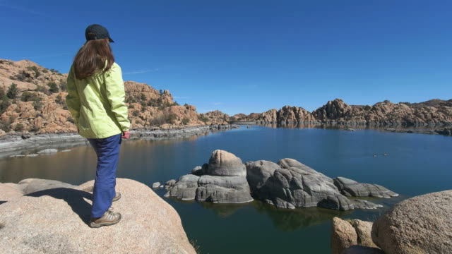 hiker woman at watson lake arizona usa - prescott arizona stock videos & royalty-free footage