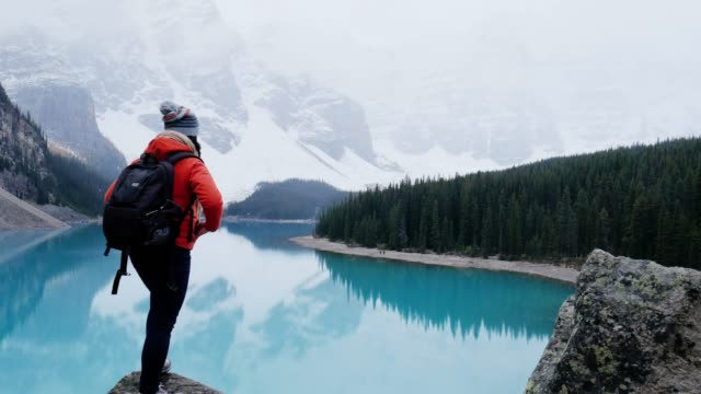 hiker woman summit mountain peak at moraine lake , banff national park , alberta canada - alberta stock videos & royalty-free footage