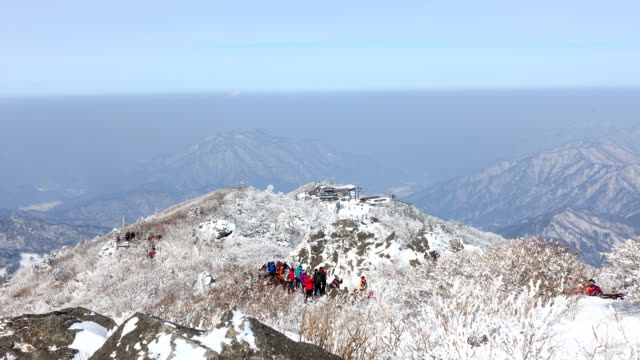 Hikers at Muju Deogyusan Resort on snow-covered Mt. Deogyusan (famous for backpacking and hiking)