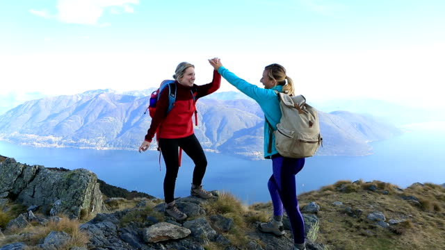 Hikers celebrating at mountain top