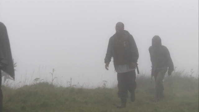 Hikers contend with wet conditions in Volcanoes National Park. Available in HD.